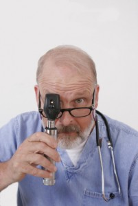 doctor with ophthalmoscope